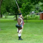 Re-enactor shouldering the musket.