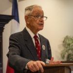 Robert W Hasbrouck, Jr. presiding over business meeting