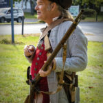 Jeff Tew, historic interpreter, presenting how to load a musket